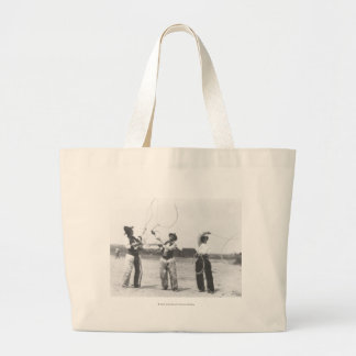 Three men lassoing. large tote bag