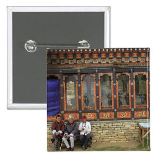 Three men sit on a bench at the Memorial Chorten 15 Cm Square Badge