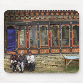 Three men sit on a bench at the Memorial Chorten Mouse Pad