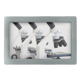 Three microscopes in a row isolated on background belt buckle