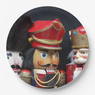 Three nutcrackers on dark background paper plate