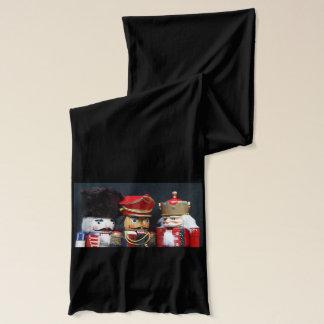 Three nutcrackers on dark background scarf