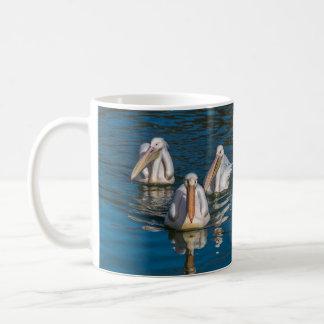 Three pelicans coffee mug