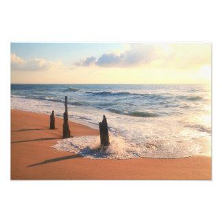 Three Posts at the surfs edge Photo