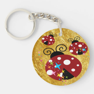 Three red and black ladybug with stars key ring