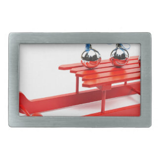 Three silver christmas balls on red sledge belt buckles