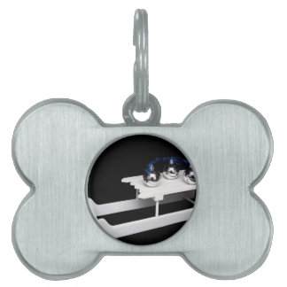 Three silver christmas balls on white sleigh pet name tag