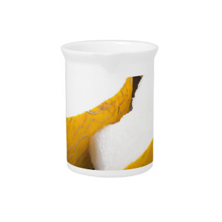 Three slices of juicy yellow melon beverage pitcher
