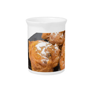 Three sugared fried fritters or oliebollen beverage pitchers