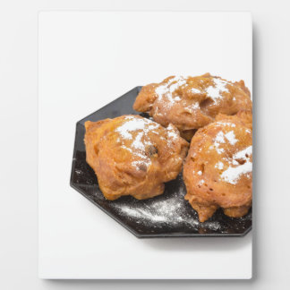 Three sugared fried fritters or oliebollen display plaque
