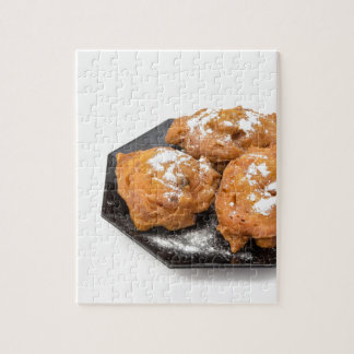 Three sugared fried fritters or oliebollen jigsaw puzzle
