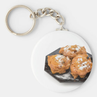 Three sugared fried fritters or oliebollen key ring
