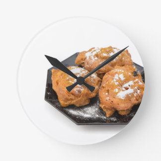 Three sugared fried fritters or oliebollen round clock
