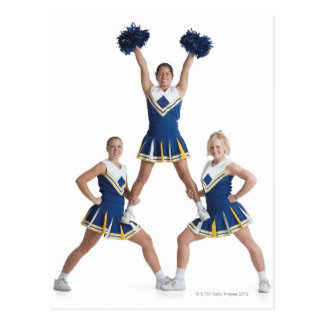 three teenage caucasian female cheerleaders in postcard