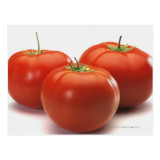 Three tomatoes on counter, close-up postcard
