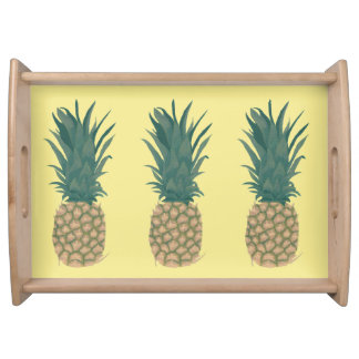 Three Whole Pineapples on Yellow Serving Trays