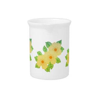 three yellow flowers pitcher
