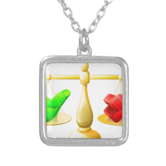 Tick and cross scales pendants