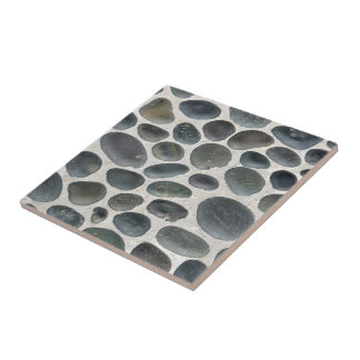 TILE WITH PEBBLE PATTERN