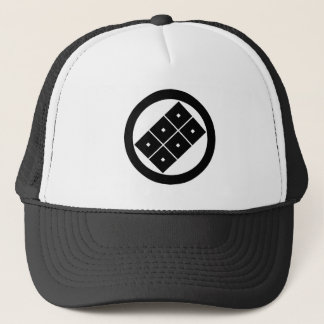Tilted six-squrae-eyes for the Horio family Trucker Hat