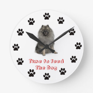 Time to feed the dog clock keeshond
