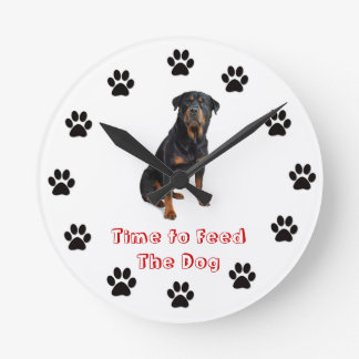 Time to feed the dog Rottweiler Round Wallclocks