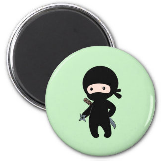Tiny Ninja Holding Throwing Star on Green Magnet