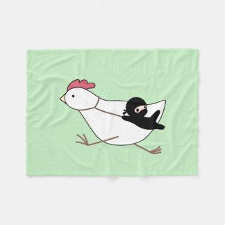 Tiny Ninja Taming Running Chicken on Green Fleece Blanket