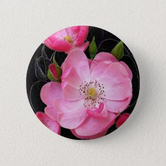 tiny rosebud opens 6 cm round badge
