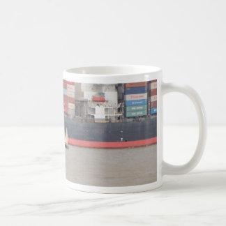 Tiny Yacht  And Huge Container Ship Basic White Mug