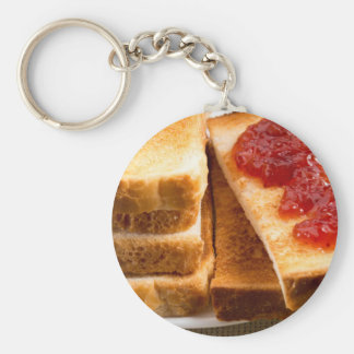 Toasted slices of bread with strawberry jam key ring