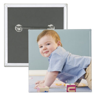 Toddler playing with blocks 15 cm square badge