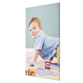 Toddler playing with blocks canvas prints