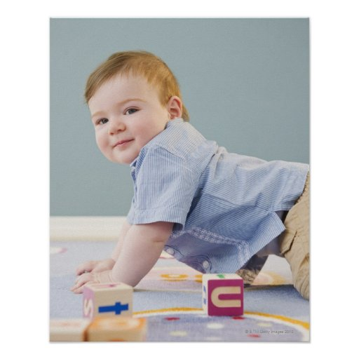 Toddler playing with blocks poster