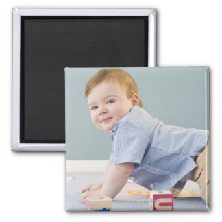 Toddler playing with blocks square magnet