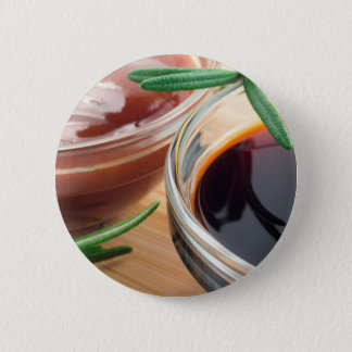 Tomato ketchup and soy sauce in a transparent bowl 6 cm round badge