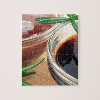 Tomato ketchup and soy sauce in a transparent bowl jigsaw puzzle