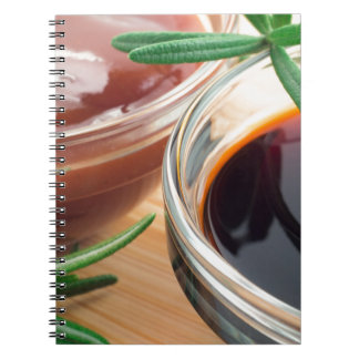 Tomato ketchup and soy sauce in a transparent bowl notebooks