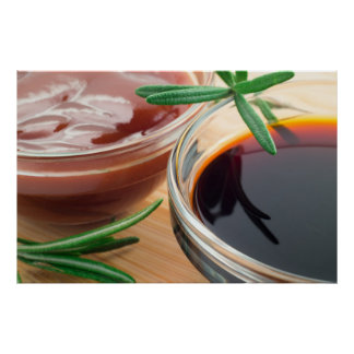 Tomato ketchup and soy sauce in a transparent bowl poster