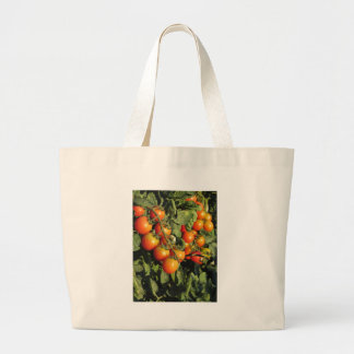 Tomato plants growing in the garden large tote bag