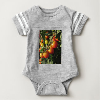 Tomato plants growing in the garden . Tuscany Baby Bodysuit