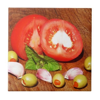 tomato with stuffed olives and garlic tile
