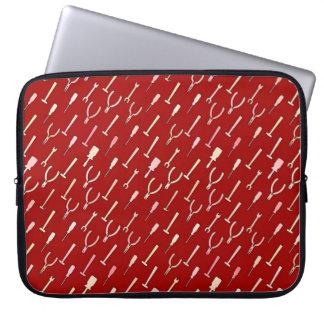 Tools, on burgundy laptop sleeves