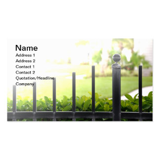 top of an outdoor black iron fence business cards