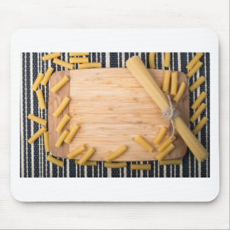 Top view food background made of thin spaghetti mouse pad