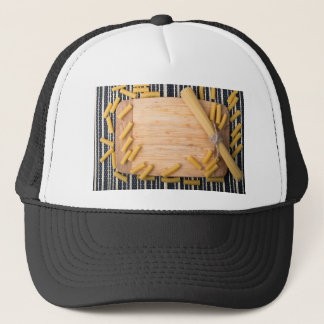 Top view food background made of thin spaghetti trucker hat