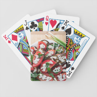 Top view of a dish of stewed aubergine bicycle playing cards