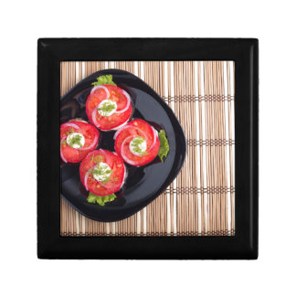 Top view of a dish with fresh sliced tomatoes gift box
