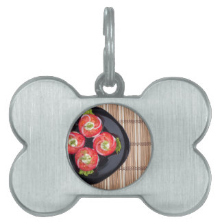 Top view of a dish with fresh sliced tomatoes pet ID tag