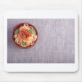 Top view of a gray mat with a spaghetti mouse pad